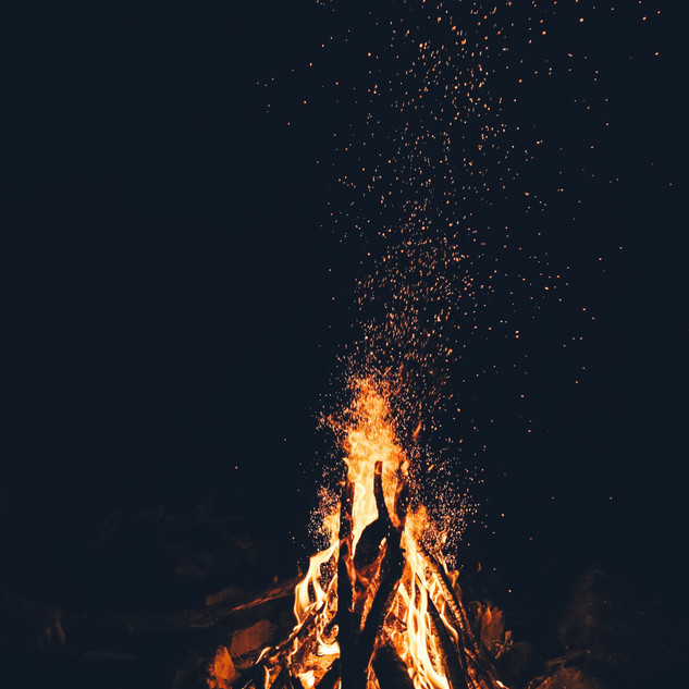 A campfire: the smell of burning wood, the peace, calm conversation, listening to the crickets, looking at the stars.