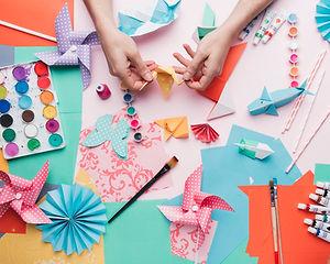 human-hand-holding-origami-bird-craft-product.jpg