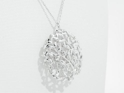 TIFFANY & Co. |  Paloma Picasso Olive Leaf Medallion Pendant