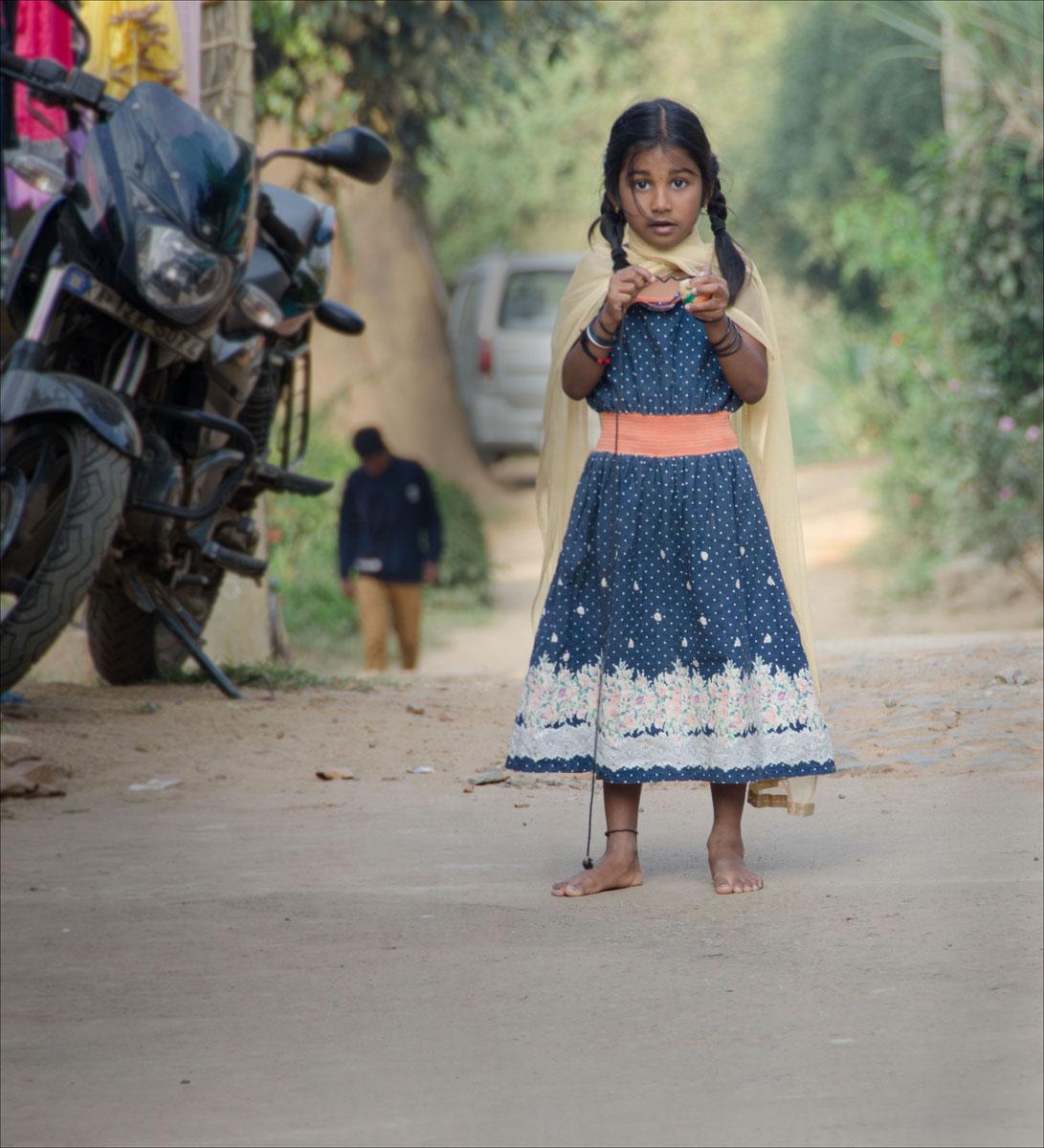 Girl next to bike