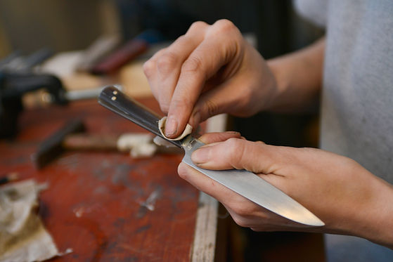 applying wax to a paring knife