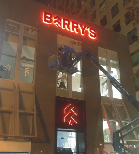 backlit store sign installation