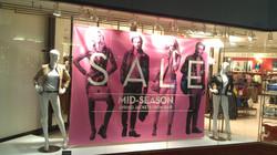 Retail sign backdrop installation