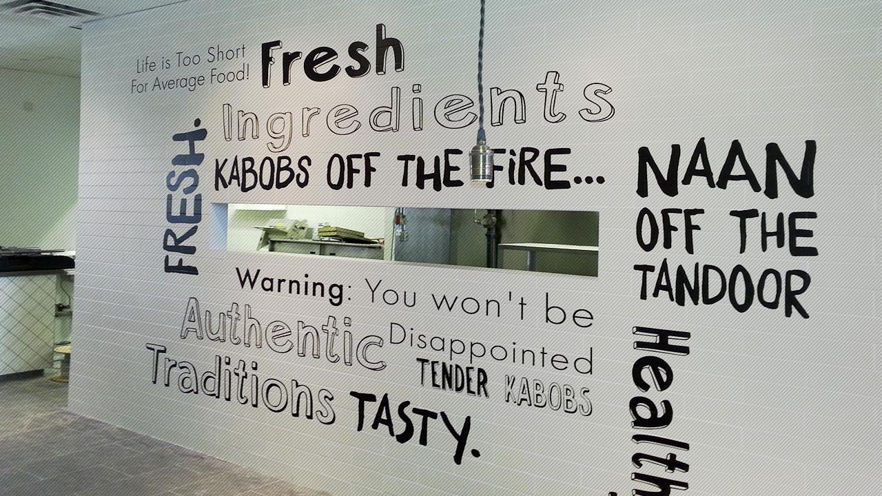 Cut lettering wall