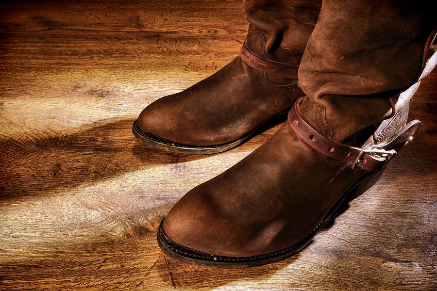 cowboy-boots-on-saloon-floor-olivier-le-queinec