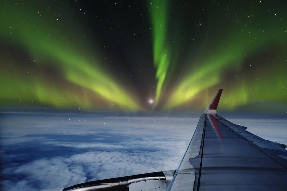 northern lights aurora plane window