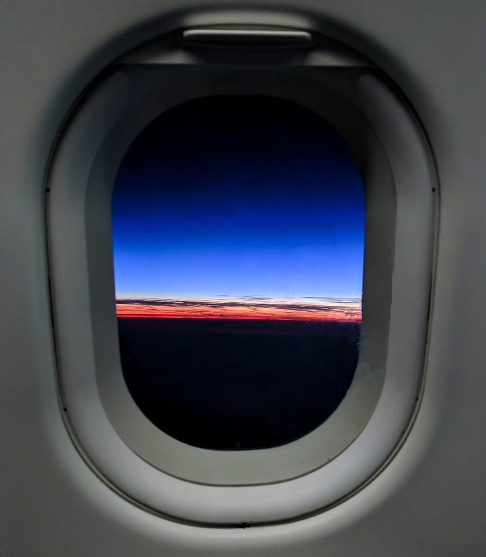 plane window sunset sky