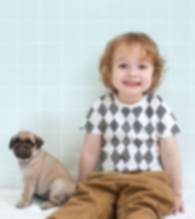 Boy with Pug Puppy