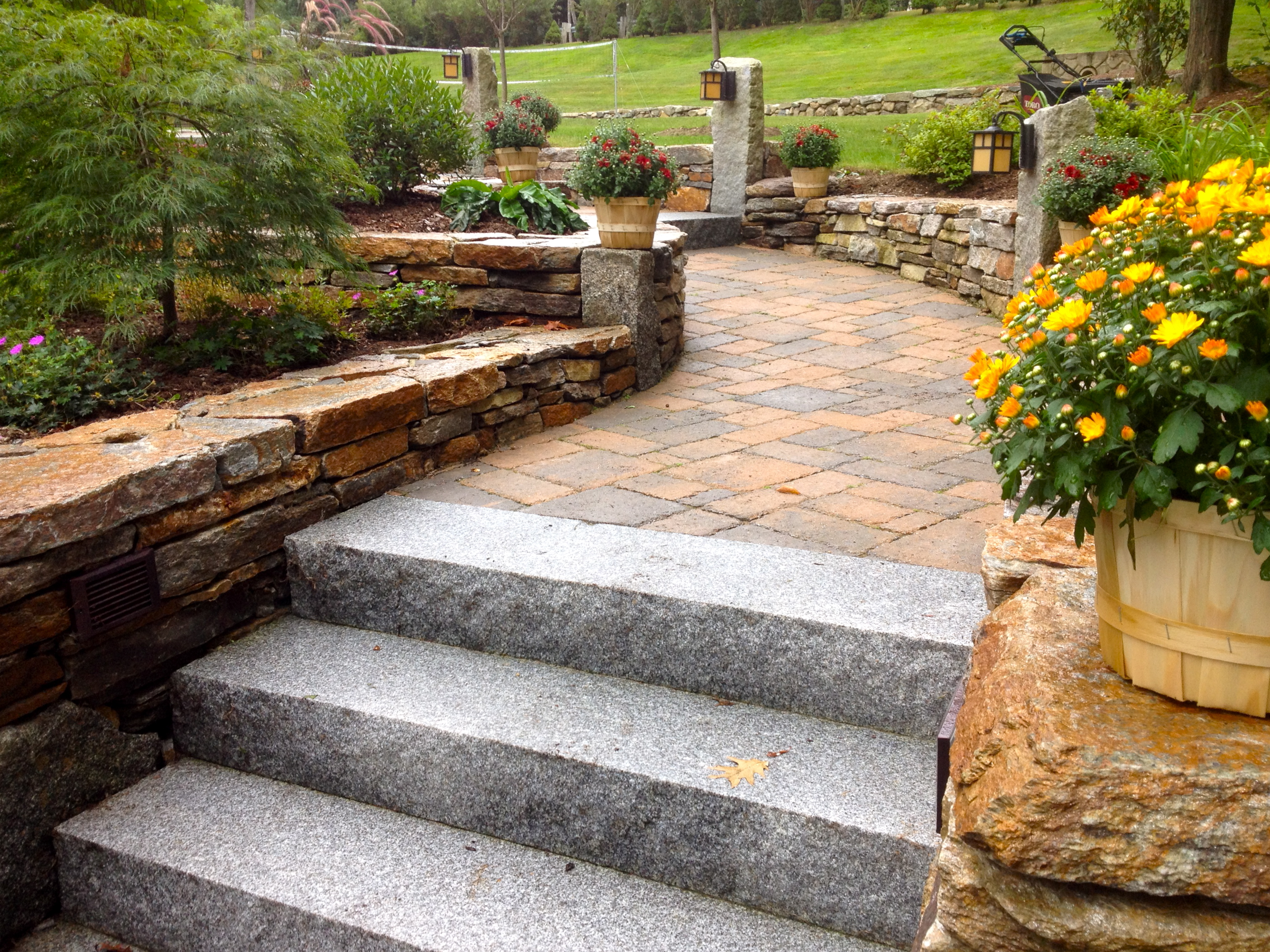 Stone Walls Bordering Front Walkway