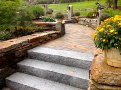Stone Walls Bordering Front Walkway