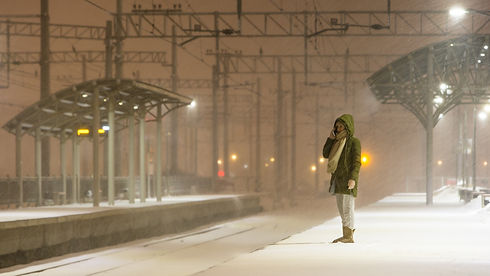 woman is waiting for the train in bad w