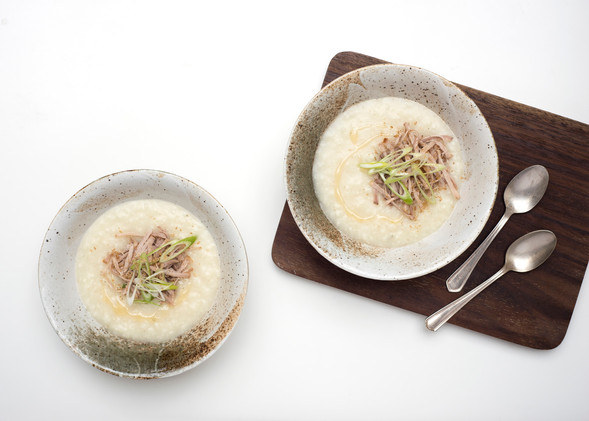Congee with shredded pork, spring onions, gomashio and chilli oil