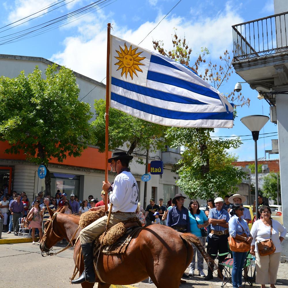 man on horseback with Uruguayan flag