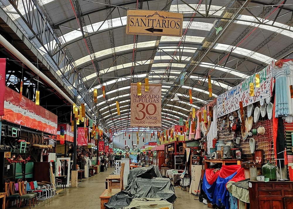 Photo of indoor flea market with furniture and trinkets