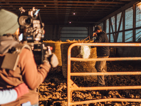 Director of Photography Jade McKenna captures TJ unwrapping a bale of hay for the cattle.