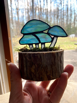 Stained glass mini mushroom sculpture on cedar