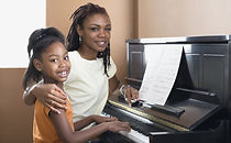 bigstock-African-mother-helping-daughte-