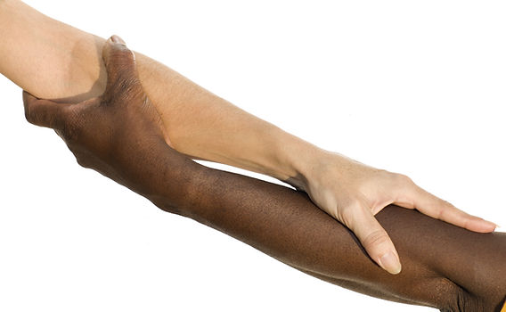 arm and hand of an African man picking u