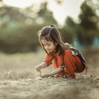 photo girl pouring sand square.jpg