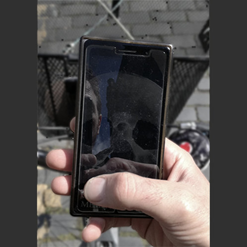 """Glass """"Memento Mori"""" mobile phone screen protector, by Jeff Zimmer"""