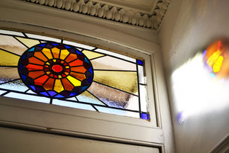 Fanlight stained glass sun.jpg