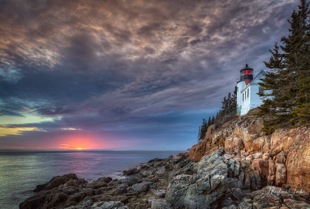 Bass Harbor Lighthouse taken at sunset and low tide.  A small group of us mentally challenged photographers travel to Maine in February. This coming February will be our fourth year. We hope to get good sunsets at scenic locations, and this was one evening when the skies lite up with color.