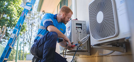 Electrican Working on Air Con.jpg