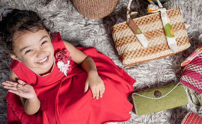A little girl in Red with Handmade Bags