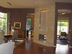 Arizona General Contractor, Fireplace, fireplace water feature, wood flooring, elegant, living room, family room, brown wall paint, dark paint, earth tone paint, double sided fireplace
