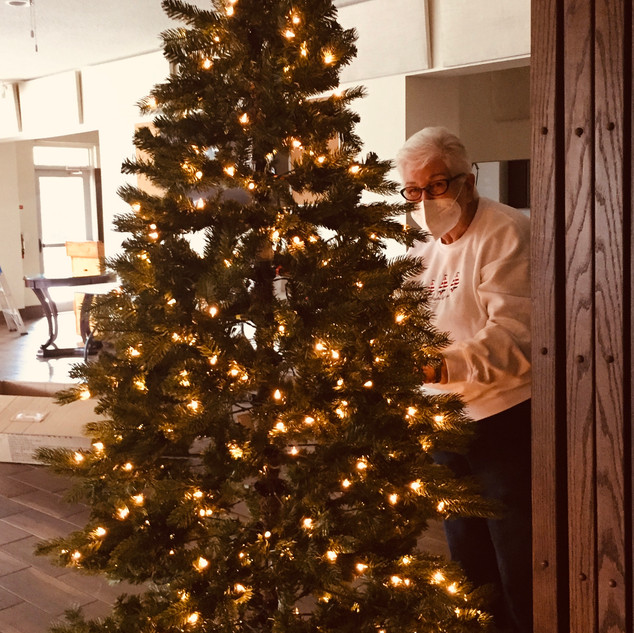 Jean LaPoint prepares a tree in the Parish Hall