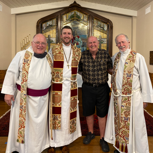 Fr. Porter and three past Rectors