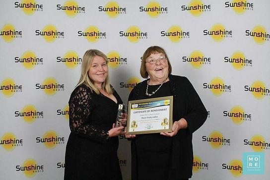 Pam and Emily with the Sunshine Pride Award 2018 for Best new business