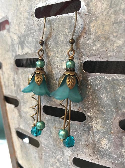 artist made blossoming teal flower dangle earrings