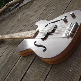 """Short scale semi hollow Telecaster style bass. Features oak fretboard with ebony dot markers made from black keys.  Scale length is 800mm/ 31.5"""" . Guide price £700"""