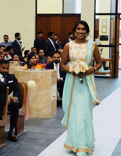 Bridesmaid walking down the aisle.JPG