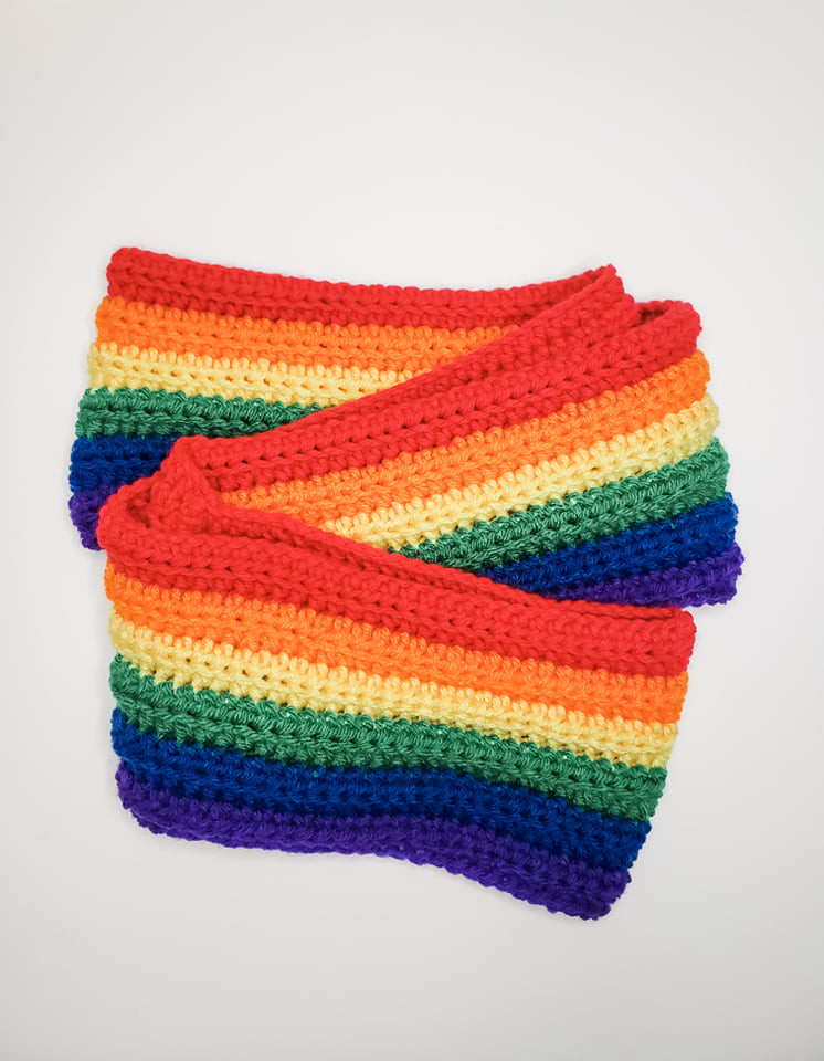The Rainbow Crochet Scarf free pattern displayed folded.