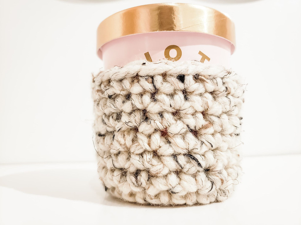 This crochet ice cream cozy is the perfect way to keep your hands warm.