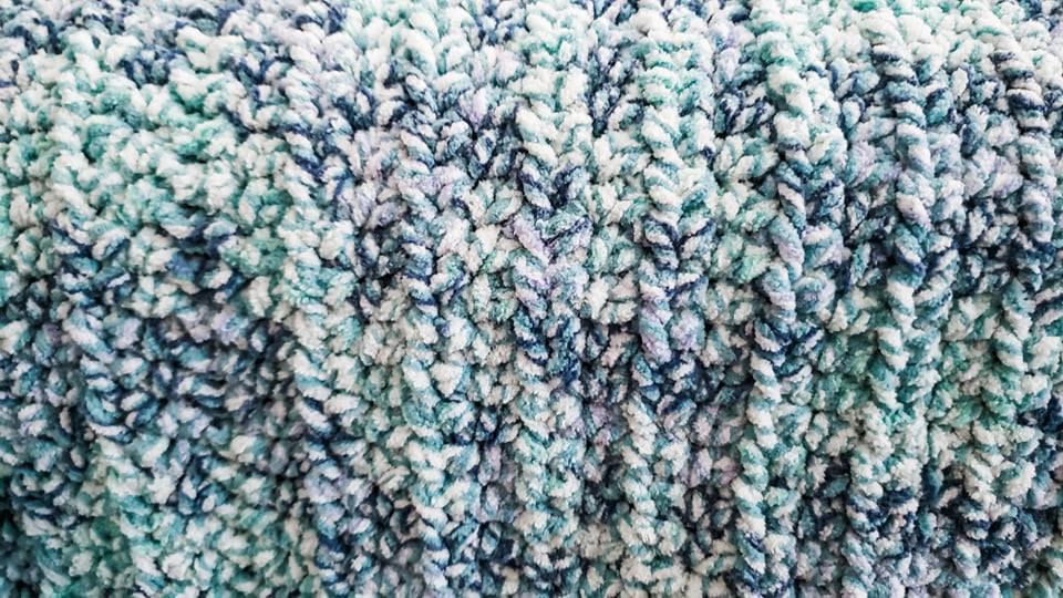 Crochet Beginner Baby Blanket using Making Waves yarn in the free pattern.