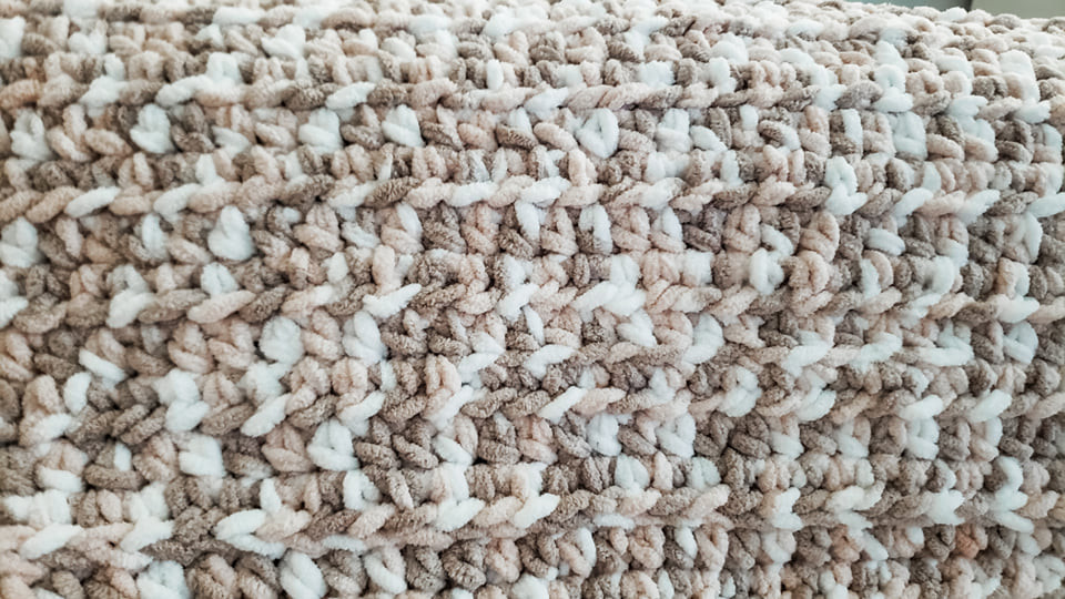 Crochet Beginner Baby Blanket free pattern is textured by using the half double crochet stitch.