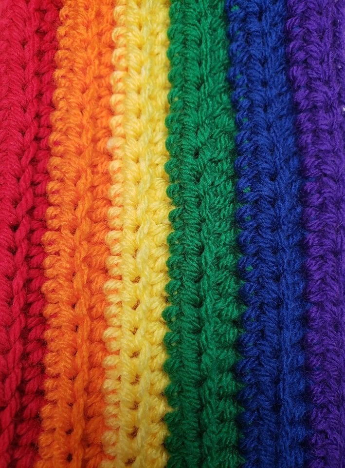 Rainbow Crochet Scarf showing rainbow of yarn colors and up close stitches.