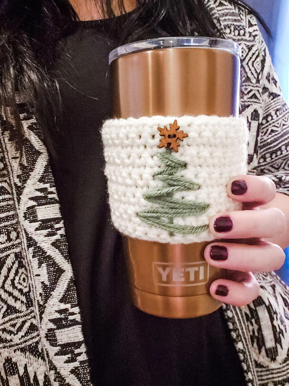The Crochet Christmas Tree cozy in hand! It fits on my yeti mug.