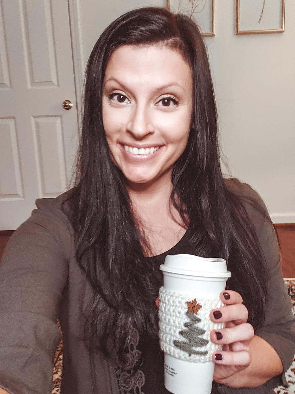 Me holding the Crochet Christmas Tree Cozy with my coffee mug.