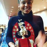 Nini and her trophy.jpg