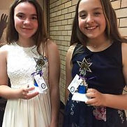 Isla and Chai with their trophies.jpg