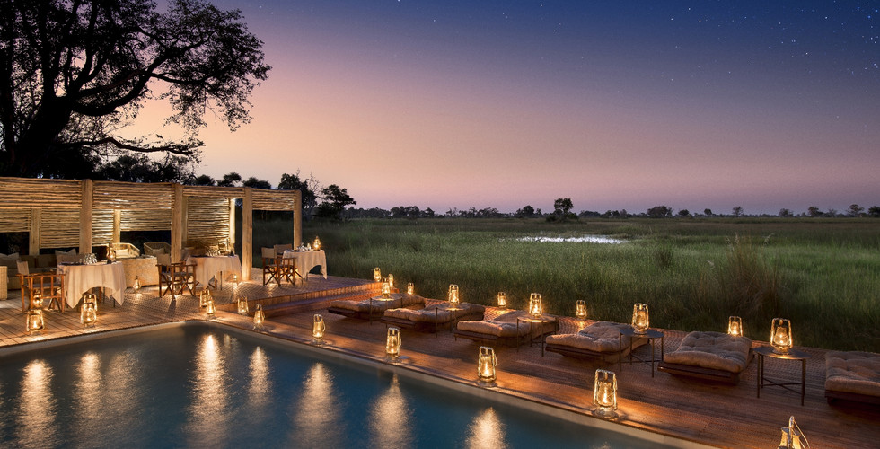 Nxabega Okavango Delta Lodge - Communal Poolside Night