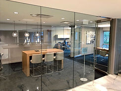 Interior image of meeting room with glass walls and glass door in Chicago, Illinois