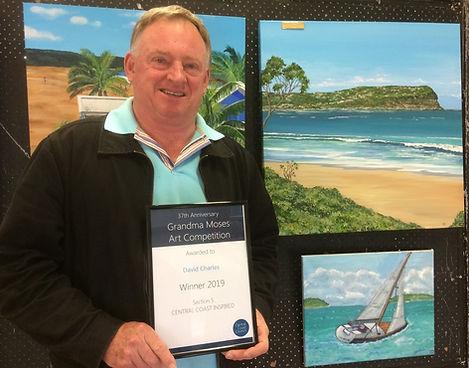 David-Charles-with-award.jpg