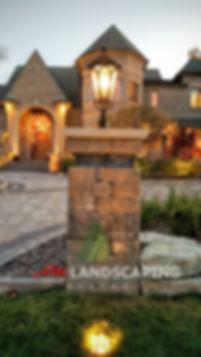 brick Paving pillars,front entrance design,brick paver driveway,am landscaping company serving macomb michigan