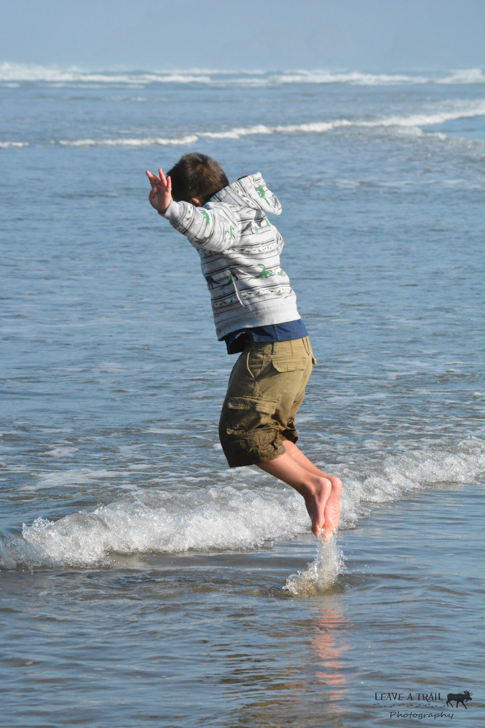 Tre Jumping in the Waves