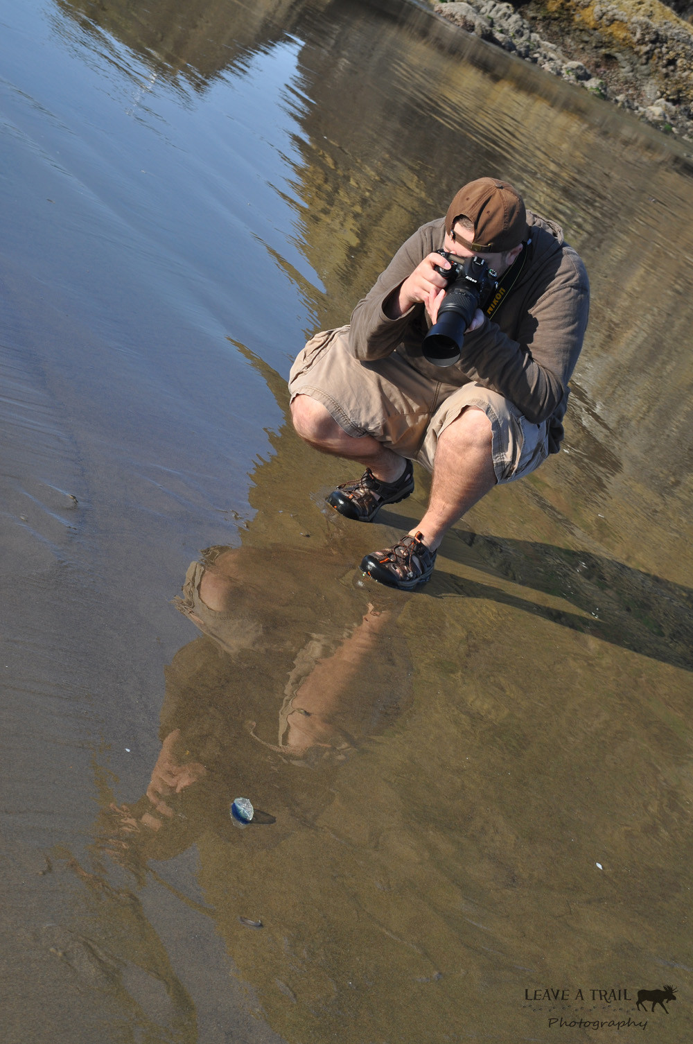 Mike Taking a Shot of the Washed Up Sea Life